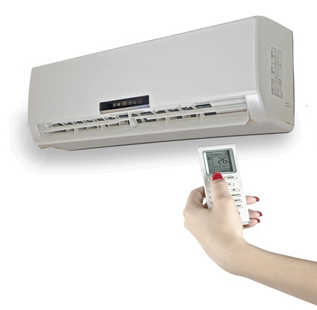 hands in the air: Remote control of air condidtioner Stock Photo