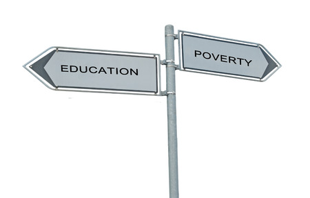 Road sign to education and poverty photo