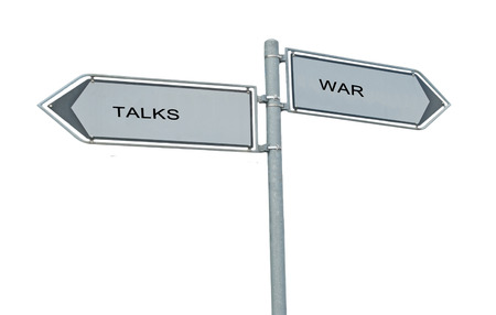 Road signs to war and talks photo
