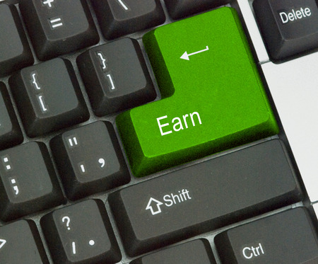 commence: keyboard with hot key for earning Stock Photo