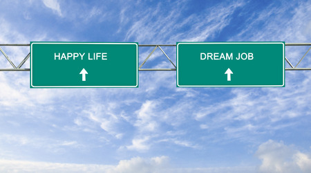 Road sign to  dream job and happy life photo