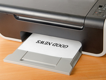 scaner: Printing good news Stock Photo