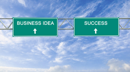 Road sign to business idea and success photo