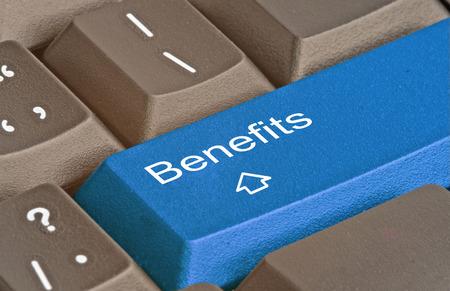 Teclado con clave para los beneficios Foto de archivo - 30349078