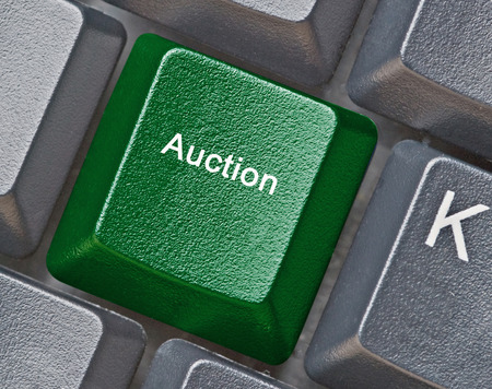 auctioning: Keyboard with key for auction Stock Photo