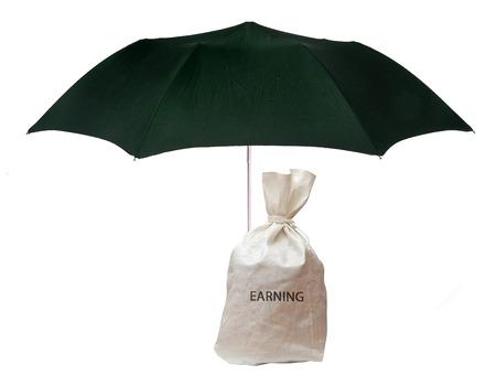 earning: Umbrella protecting earning