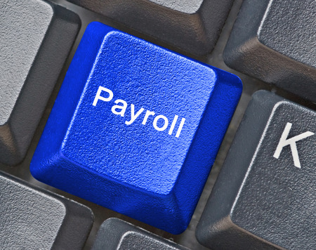 Keyboard with key for payroll Stockfoto