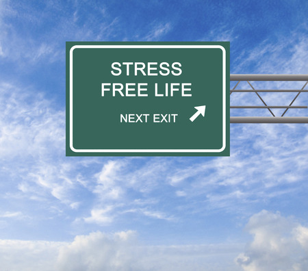 stress free: Road Sign to Stress Free Life Stock Photo