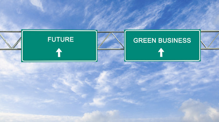 street signs: road sign to green business and future
