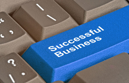 sucessful: Keyboard with key for sucessful business Stock Photo