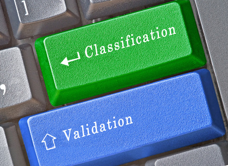 validation: keyboard with keys for classification and validation Stock Photo