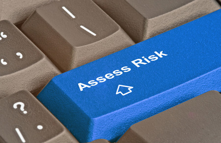 Keyboard with key for risk assessment Stock Photo