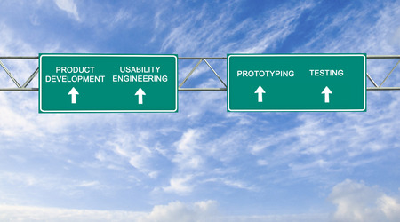 porting: road sign to product development Stock Photo