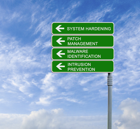 Road sign to system hardening Stock Photo