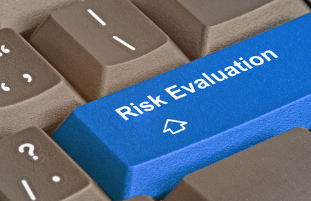 Keyboard with blue key for risk evaluation Archivio Fotografico