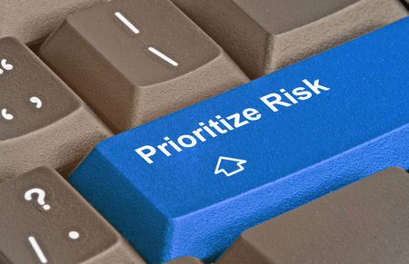Keyboard with key for risk prioritization