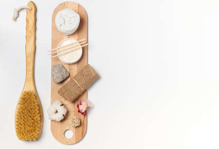 Visualization of spa care with massagers and washcloths made of natural materials. Eco-friendly materials for body care