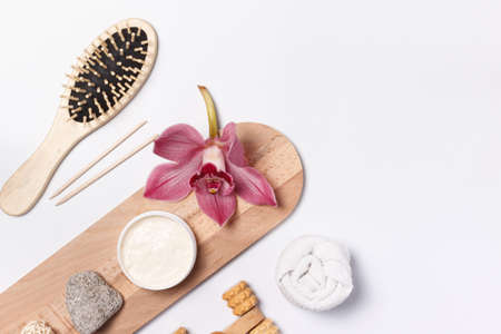 Eco-friendly Items for body and skin care made of natural materials. Wooden comb, manicure sticks, pumice stone, dry massage brush. layout On a white background, with space