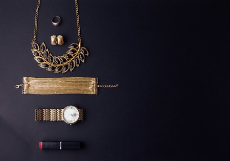 Set of stylish accessories on black background