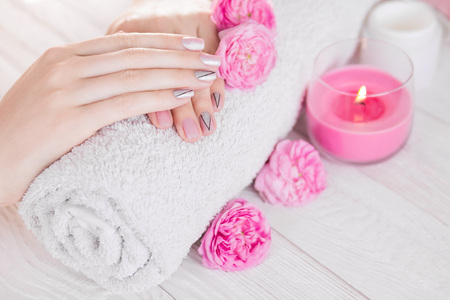 Beautiful pink manicure with silver triangles surrounded with roses