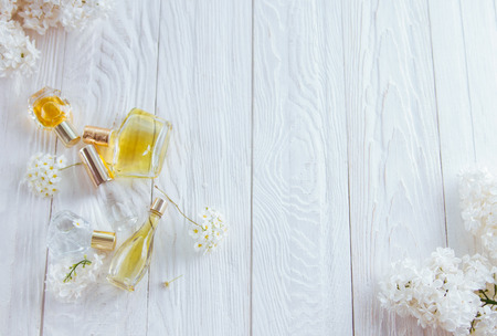 Bottles of perfume with white flowers on wooden background stock bottles of perfume with white flowers on wooden background stock photo 95960807 mightylinksfo