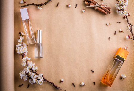Bottles of perfume with ingredients on paper 스톡 콘텐츠