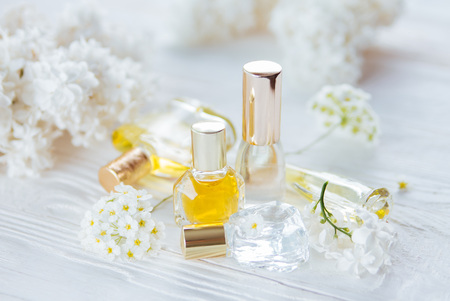 Bottles of perfume with white flowers on wooden background stock bottles of perfume with white flowers on wooden background stock photo 95960582 mightylinksfo