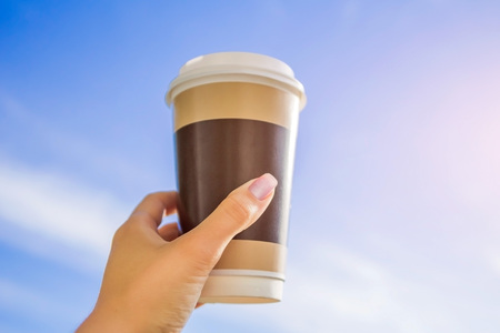 Cup of coffee against the blue sky in the morning