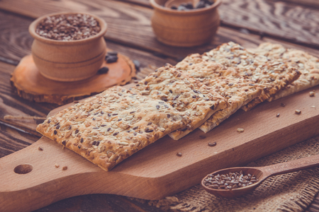 Healthy biscuits with grains and seeds on wooden table