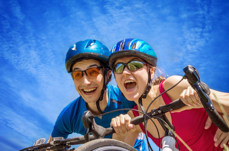Couple of bikers against the blue sky Stock Photo