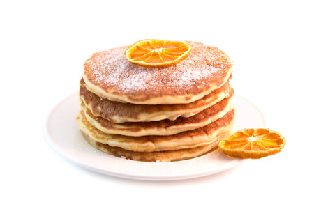 Stack of pancakes with sugar powder isolated on white background. Tasty dessert