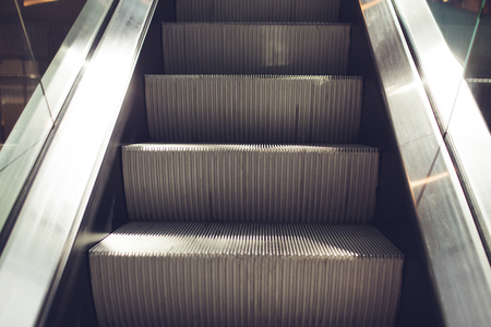 Modern escalator in shopping center. Electronic system moving. Empty escalator in business center.