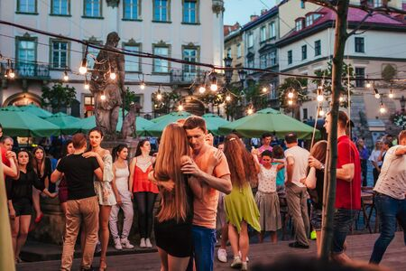 Lviv, Ukraine - August 4, 2018. People dancing salsa and bachata in outdoor cafe in Lviv