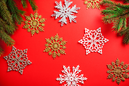 Red Christmas and New Year background with snowflakes and fir tree. Holiday symbol