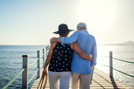 Senior couple walking on pier by Red sea. People enjoying vacation. Valentines day
