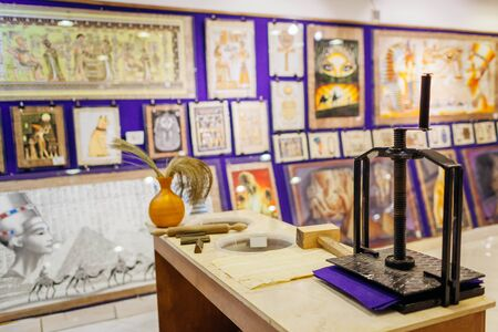 January 27, 2019 - Egypt, Sharm El-Sheikh. Papyrus painting displayed in store with device for papyrus making