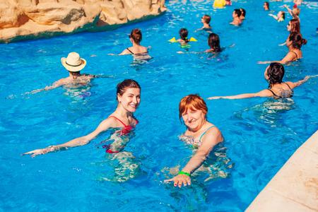 January 28, 2019 - Egypt, Sharm El-Sheikh. People doing exercises during acqua aerobics in hotel swimming pool.