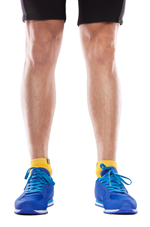 Man wearing blue sneakers isolated on white background