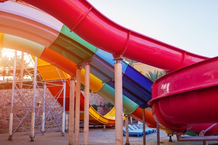 Empty water slide in hotel aquapark. Resort entertainment. Summer vacation