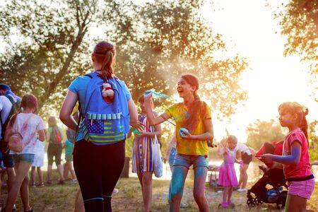 Myrhorod, Ukraine - June 16, 2019: Two girls throwing paints on indian Holi festival of colors Publikacyjne
