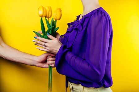 Man giving bouquet of tulips flowers to girlfriend. Valentines day present. Women's day gift. Stock Photo - 137502078
