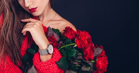 Valentines day. Woman holding bouquet of red roses. Beautiful girl received romantic present. Flowers delivery. Space
