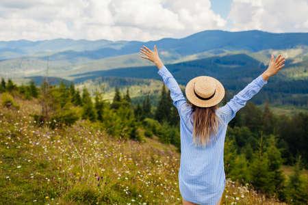 Traveling in summer Ukraine. Trip to Carpathian mountains. Happy woman tourist hiking raising arms enjoying natural landscape. Hiking Archivio Fotografico