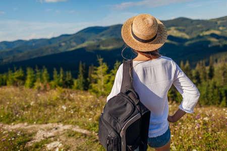Trip to Carpathian mountains. Happy woman tourist hiking enjoying wild nature landscape. Traveling in summer Ukraine Archivio Fotografico