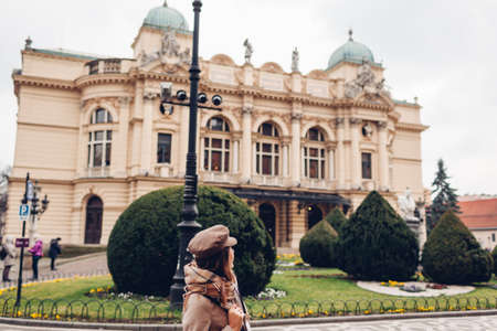 Tourist admiring Krakow Slowackiego theater exterior in Poland. Architecture, landmarks of Krakow old city. Tourist attraction