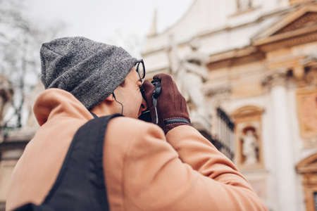 Tourist takes pictures of St Peter and Paul church in Krakow, Poland. Sightseeing around landmarks and ancient architecture.