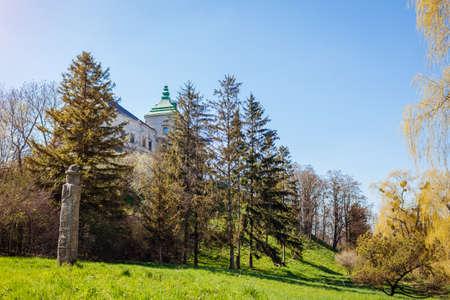 View of Olesko Castle from spring garden. Ancient architecture, landmarks, places of interest in Western Ukraine. Traveling in Lviv region