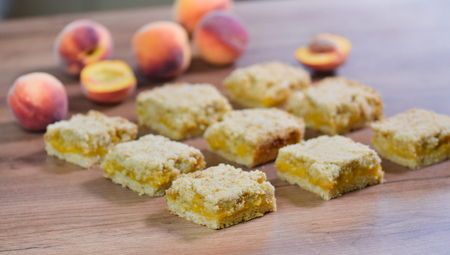 Homemade Peach Crumble Bars on the table
