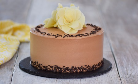 Chocolate cake decorated with white flowers