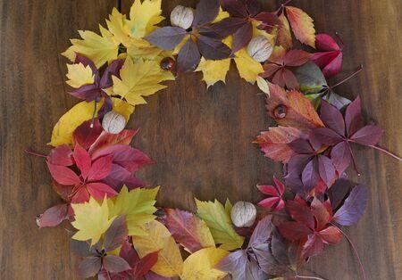 Autumn leaf on wood black background top view orange leaf on old grunge wood deck, copy place for inscription, tablet for text, Stok Fotoğraf